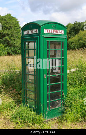 K6 telephone box, designed by Giles Gilbert Scott in 1936, painted green.  Fangdale Beck, North Yorkshire - Stock Photo
