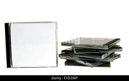 Blank CD case facing forward next to stack isolated on white - Stock Photo
