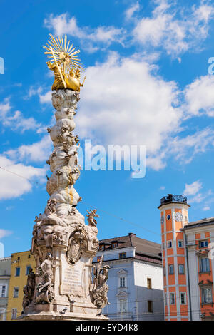 Image of the Holy Trinity Column and the town hall in the background in Linz, Austria - Stock Photo
