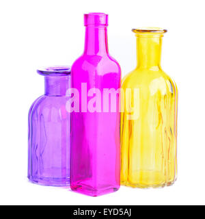 Three colorful bottles, isolated on white background - Stock Photo