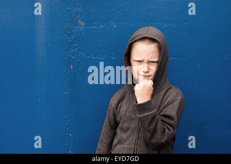 angry aggressive boy (child) shows his fist, threatening - Stock Photo