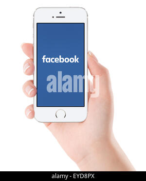 Varna, Bulgaria - February 02, 2015: Female hand holding Apple silver iPhone 5S with Facebook new logo on the screen. - Stock Photo