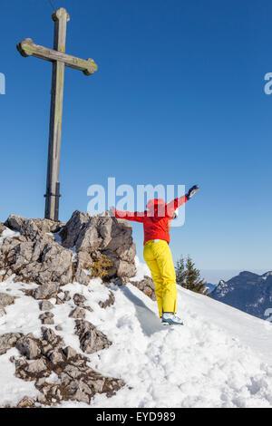 Ski holiday, Happy skier jumping on mountain peak, Sudelfeld, Bavaria, Germany - Stock Photo