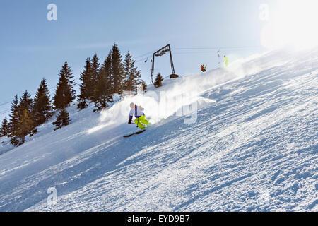 Ski holiday, Skier carving downhill, Sudelfeld, Bavaria, Germany - Stock Photo