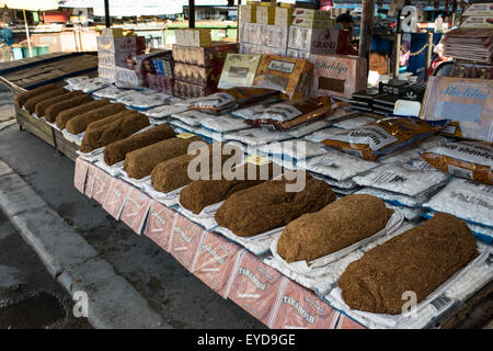 Loaves of raw tobacco, Gran Bazar, Tirana Albania - Stock Photo