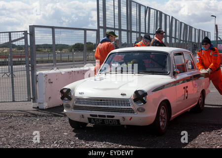 Collapsed rear suspension on this 1965, Ford Lotus Cortina  Mk1, caused it to retire from a race at  the Silverstone - Stock Photo