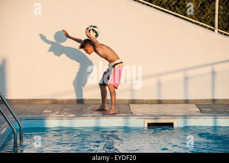 A Boy Plays With His Football Performing Freestyle Tricks By A Stock Photo Royalty Free Image