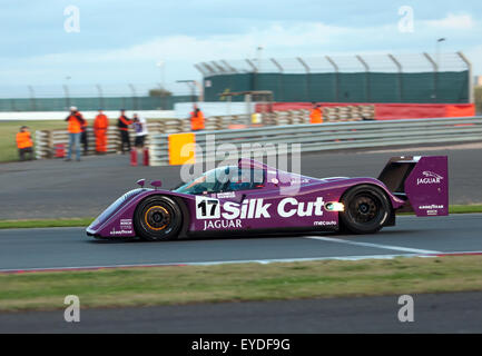Christophe D'Ansembourg driving  a 1991, Jaguar XJR14 in the Group C race at the Silverstone Classic 2015. - Stock Photo