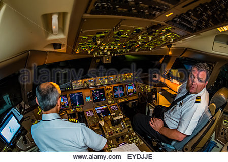 Pilots in the cockpit prepare the Delta Airlines Boeing 777-200LR  for the 17 hour flight from Atlanta, Georgia - Stock Photo