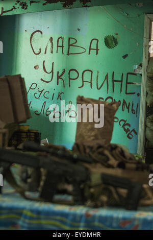 Shyrokyne, Donetsk Oblast, Ukraine. 22nd July, 2015. Graffiti in a sniper position of the ukrainian army in Shyrokyne - Stock Photo