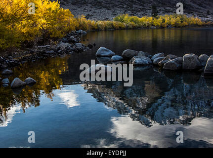 Early morning reflections on Convict Lake, Sierra Nevada Mts - Stock Photo