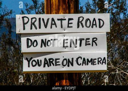 Sign  on private ranch road , Mojave Desert, California - Stock Photo