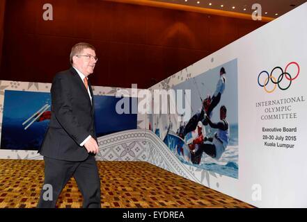 Kuala Lumpur, Malaysia. 28th July, 2015. International Olympic Committee (IOC) President Thomas Bach walks into - Stock Photo