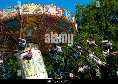 Festival Goers Having A Ride On A Waveswinger At Lovebox Festival In Victoria Park, London, Uk - Stock Photo