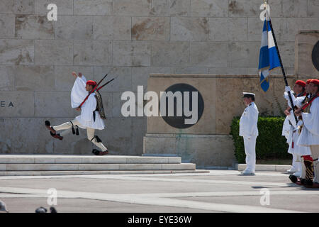 Evzones goose stepping during a ceremony at the Unknown soldier memorial in Syntagma, Athens, Greece. - Stock Photo