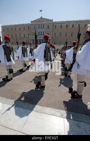 Evzoni infantry presenting arms during a ceremonial event attended by tourist crowds opposite Parliament site, Syntagma, - Stock Photo