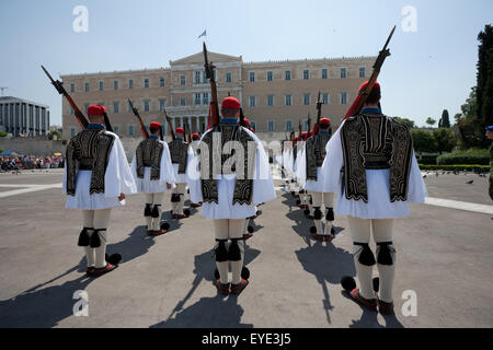 Evzones infantry standing at attention during a ceremonial event attended by tourist crowds in central Athens, Syntagma, - Stock Photo
