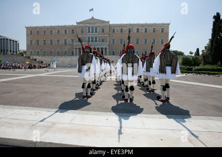 Regiment of Evzones and their shadows during a ceremonial event attended by tourist crowds, in central Athens, Syntagma, - Stock Photo