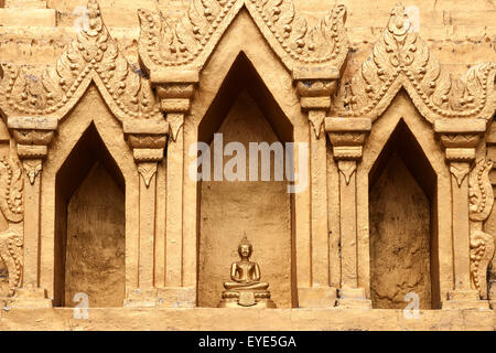 Small Buddha statue in a niche of the Wat Jong Kham, Kyaing Tong, Golden Triangle, Shan State, Myanmar - Stock Photo
