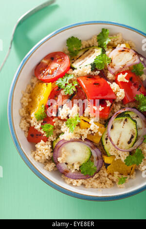 healthy couscous salad with tomato pepper zucchini onion - Stock Photo