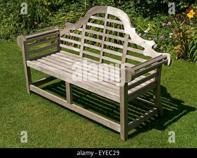 Wonderful Ornate Wooden Garden Bench Seat On Green Lawn, Barnsdale Gardens, Rutland,  England,