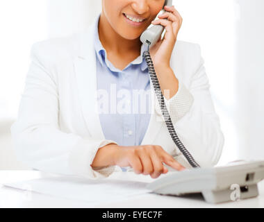 african businesswoman with phone in office - Stock Photo