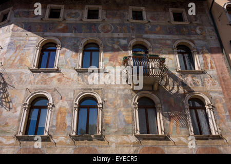 Fresco facades on historic buildings in Piazza Duomo, Trento. - Stock Photo