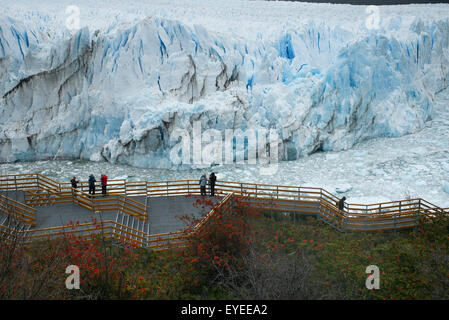 Tourists viewing Moreno Glacier, Los Glaciares National Park; Santa Cruz province, Argentina - Stock Photo