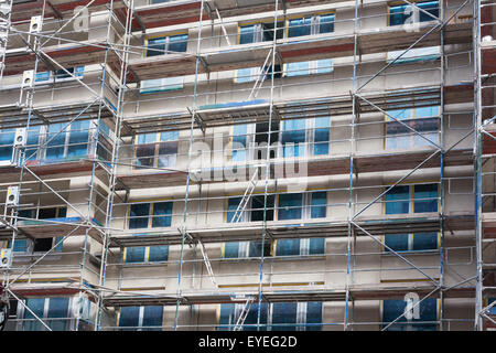 building with scaffolding - house construction site - Stock Photo