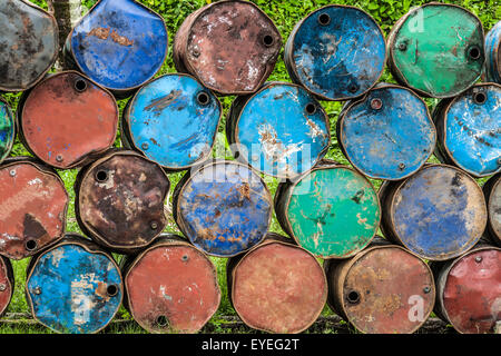Stack of rusted steel oil drums - Stock Photo