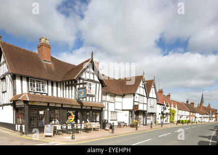 Cafe and ice cream parlour timber framed cottages line the high street in Henley in Arden, Warwickshire, England, - Stock Photo