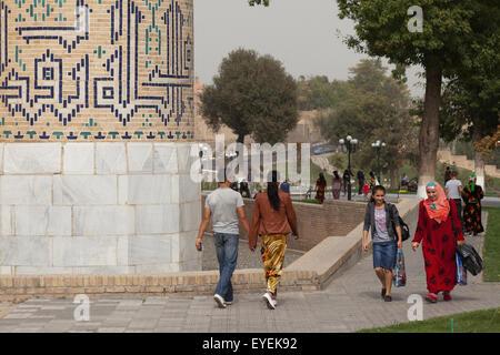 Pedestrians on a Tashkent street, beside Bibi Khanum mosque; Samarkand, Uzbekistan - Stock Photo
