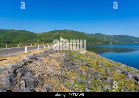 View of reservoir blue sky and green grass, Blue scence in the morning - Stock Photo