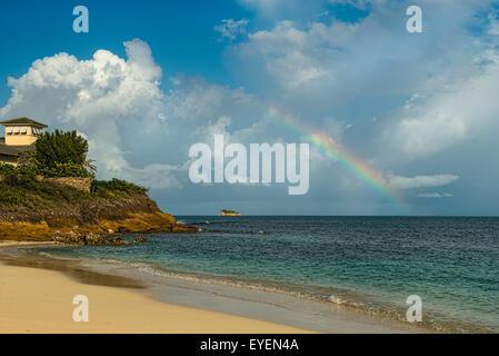 Rainbow over Dickenson Bay; St. John's, Antigua, West Indies - Stock Photo