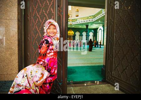 Girls prepare to enter Jame'Asr Hassanil Bolkiah Mosque; Bandar Seri Begawan, Brunei - Stock Photo