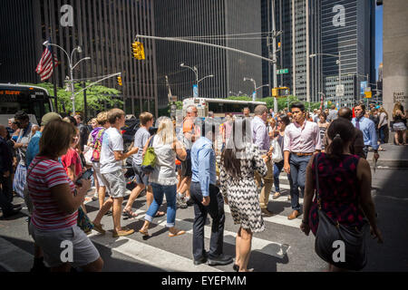 Pedestrians cross a busy Fifth Avenue intersection in New York on Thursday, July 23, 2015. (© Richard B. Levine) - Stock Photo