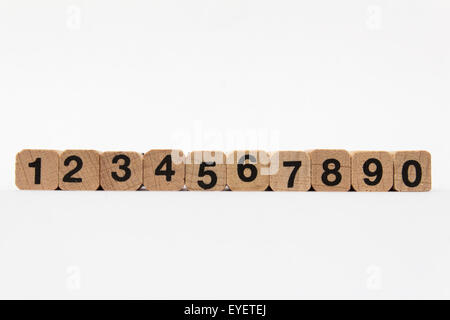 Numbers one to ten on wood cubes isolated on white background - Stock Photo