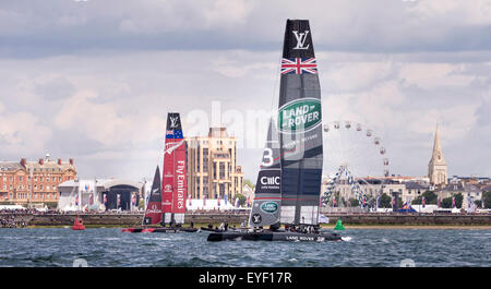 Sir Ben Ainslie's AC45 catamaran, Land Rover BAR, and Emirates Team New Zealand before the first day's competition - Stock Photo