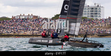 Sir Ben Ainslie's AC45 catamaran passes supporters on the shore before the first day's competition in the America's - Stock Photo