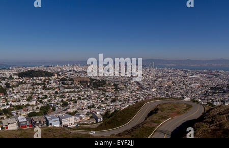 Sharp Bend In The road At Twin Peaks, high above The City of San Francisco affording tremendous views of the city - Stock Photo