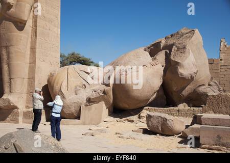 Fallen statue of Ramesses II (Ozymandias), Ramesseum funerary temple, West Bank; Luxor, Egypt - Stock Photo