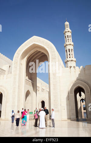 Tourists at Sultan Qaboos Grand Mosque; Muscat, Oman - Stock Photo