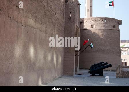 Three Vintage Cannon Guard The Entrance to Al Fahidi Fort Dubai - Stock Photo
