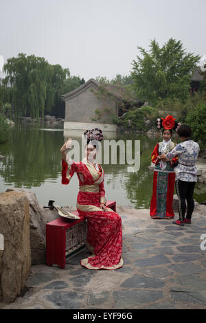 Posing for photographs in historical dress costumes, in Fengxuan Park, in Beijing, China. - Stock Photo