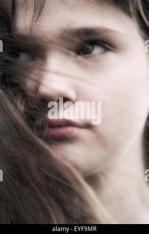 headshot of a young and sad teenage girl Stock Photo