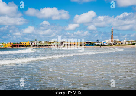 Lighthouse and accommodation buildings along the waterfront; Cabo Polonio, Uruguay - Stock Photo