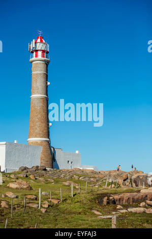 Lighthouse and rocks; Cabo Polonio, Uruguay - Stock Photo