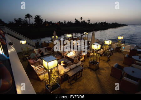 Early evening drink aboard nile cruise boat near luxor; west bank luxor upper egypt - Stock Photo