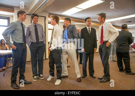 Formally dressed teenage boys talk in the parish hall while awaiting confirmation at a Laguna Niguel, CA, Catholic - Stock Photo