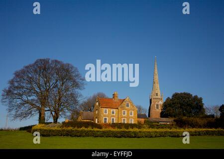 Braunston church and hotel; Braunston, Northamptonshire, England - Stock Photo